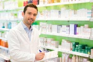 pharmacist taking notes at work