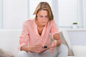 Woman Checking Blood Sugar Level