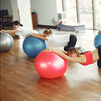 Women with exercise balls