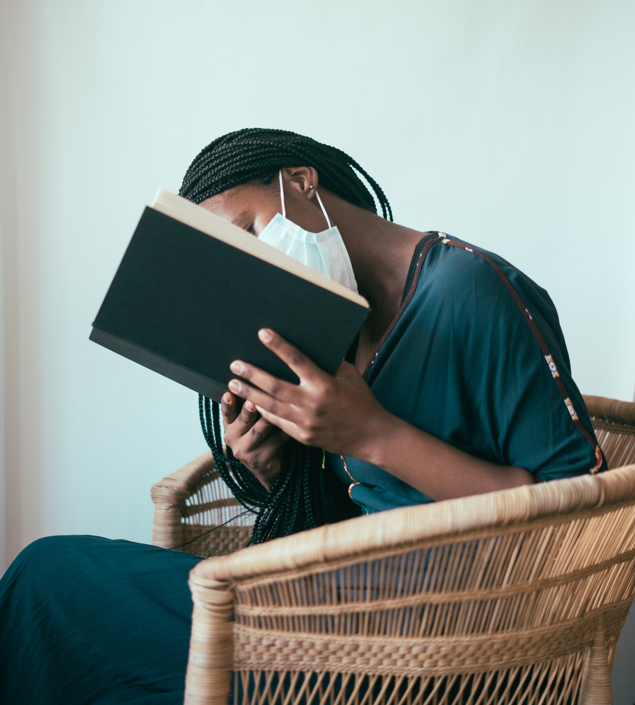 Woman wearing a mask reading